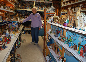 Shirley Squires of Guilford, Vt., near a cabinet, which houses many of her Nativity sets year round.